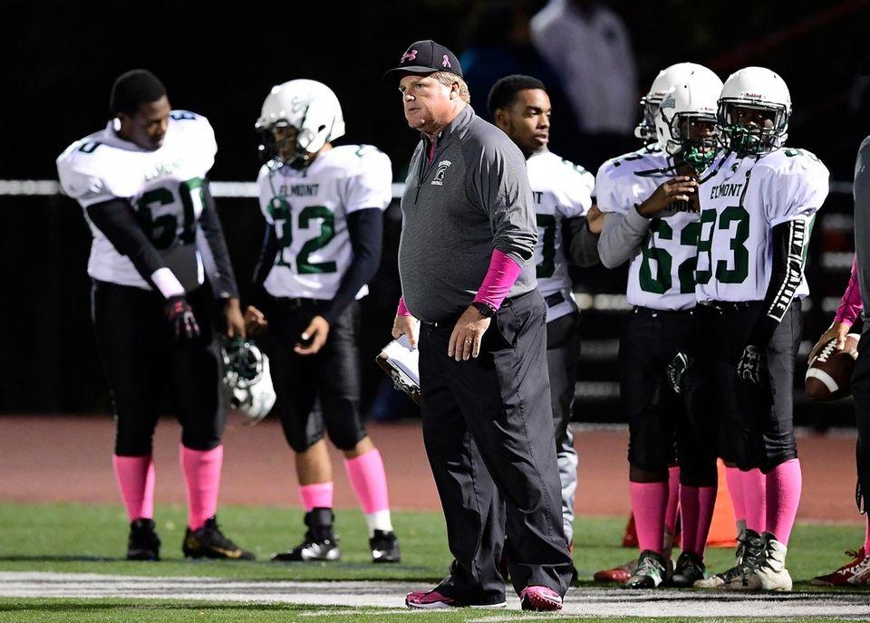 Head coach Jay Hegi of Elmont looks on