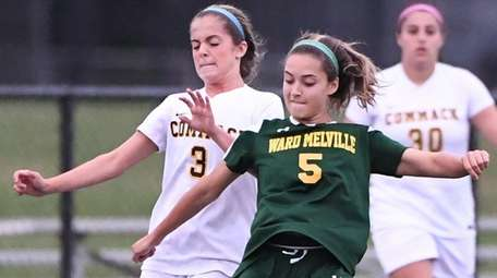 Ward Melville's Nicole Hauss kicks the ball against