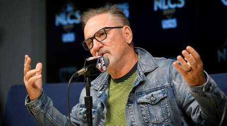 Cubs manager Joe Maddon speaks during a press