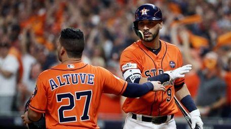 Jose Altuve #27 of the Houston Astros celebrates