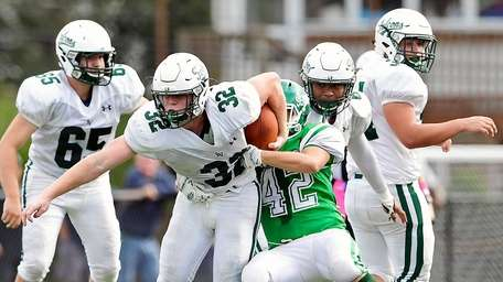 Thomas O'Brien #32 of Locust Valley is tackled