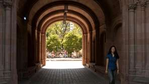 A student at Yale University walks on campus.