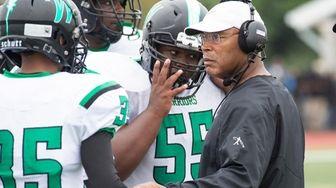 Wyandanch coach Dwight Singleton talks to his players