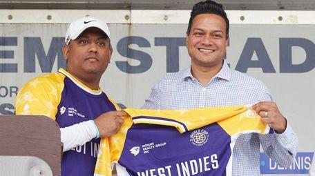 Tony Subraj, right, of New Hyde Park, receives