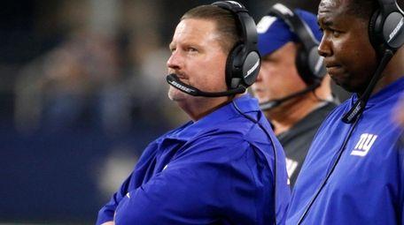 New York Giants head coach Ben McAdoo watches