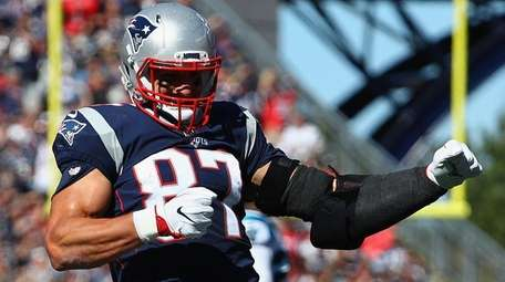 Patriots tight end Rob Gronkowski reacts after a play against