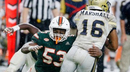 Miami linebacker Zach McCloud attempts to take down