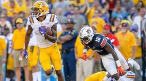 LSU wide receiver D.J. Chark returns a punt