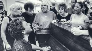 Songwiter Ellie Greenwich, center, rehearses with the cast