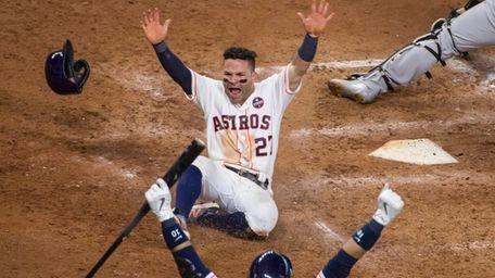 Houston Astros Jose Altuve celebrates after scoring on