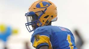 Lawrence quarterback Christian Fredericks during a game against
