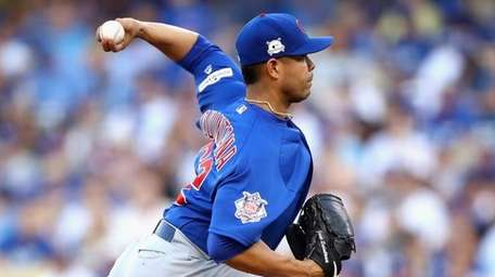 Jose Quintana of the Chicago Cubs throws a
