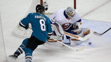 Islanders goalie Thomas Greiss stops a shot by