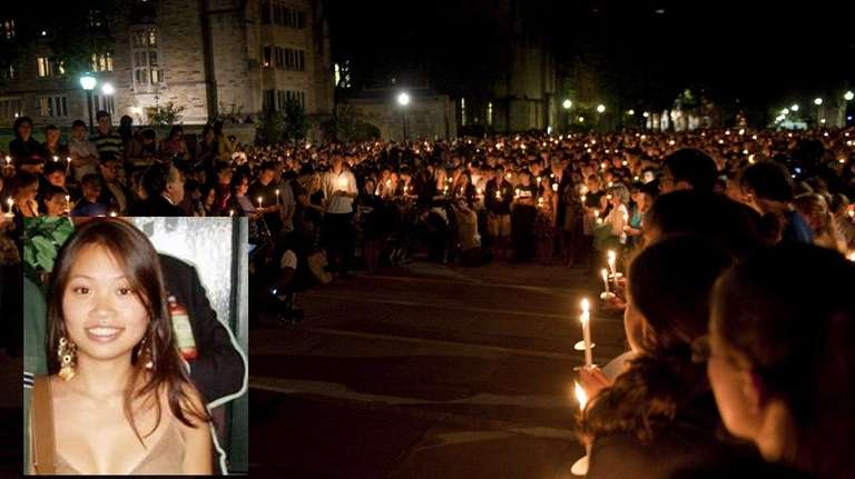 Yale students attend a candlelight vigil for Annie