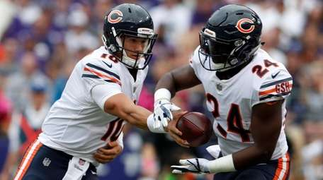 Quarterback Mitchell Trubisky of the Bears hands off