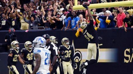 New Orleans Saints defensive end Cameron Jordan celebrates