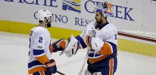 Islanders goalie Thomas Greiss is greeted by teammate