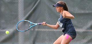 Rachel Arbitman of Hewlett hits a return against