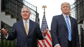 Secretary of State Rex Tillerson, left, with President
