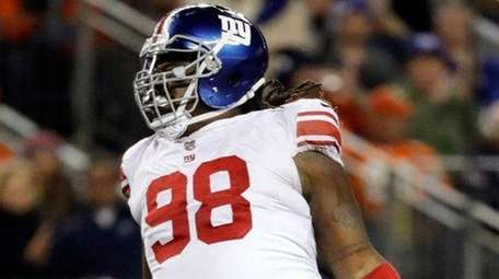 Giants defensive tackle Damon Harrison reacts after sacking