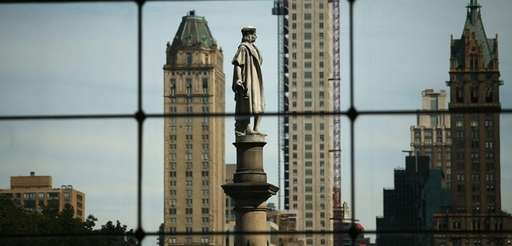 A 76-foot statue of explorer Christopher Columbus stands