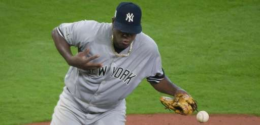 Luis Severino is hit with a batted ball