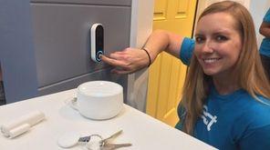 Nest program manager Aubrey Thelen demonstrates the Hello