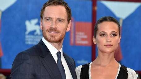 Actors Michael Fassbender and Alicia Vikander attend the