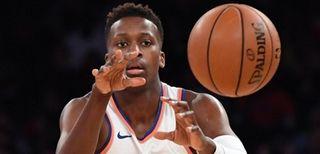 Knicks guard Frank Ntilikina passes the ball against