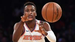 Knicks guard Frank Ntilikina passes the ball against