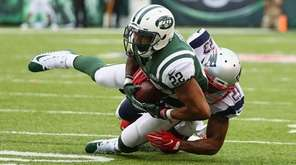 Patriots safety Patrick Chung tackles Jets running back Matt