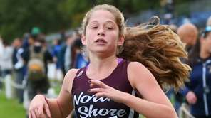 Lizzie Lockwood of North Shore crosses the finish