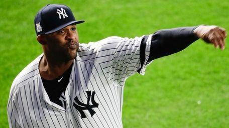 New York Yankees starting pitcher CC Sabathia warms