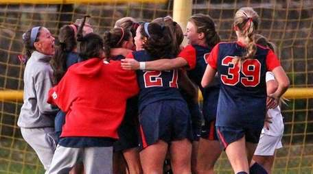 South Side celebrates a last second goal to