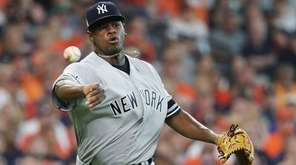 Luis Severino of the Yankees fields a ground