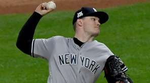 Yankees pitcher Sonny Gray throws during the third