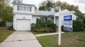 This four-bedroom home in Syosset, seen here on