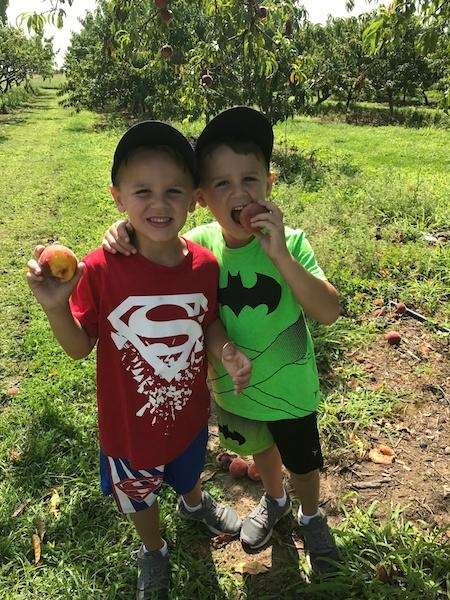 Identical Twins peach picking