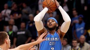 Carmelo Anthony of the Oklahoma City Thunder puts