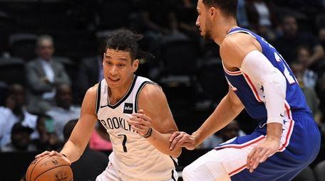 Brooklyn Nets guard Jeremy Lin drives the ball