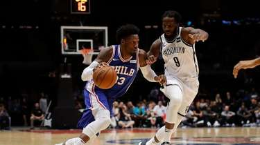 Philadelphia 76ers forward Robert Covington drives against Brooklyn