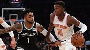 Knicks guard Frank Ntilikina is defended by Brooklyn