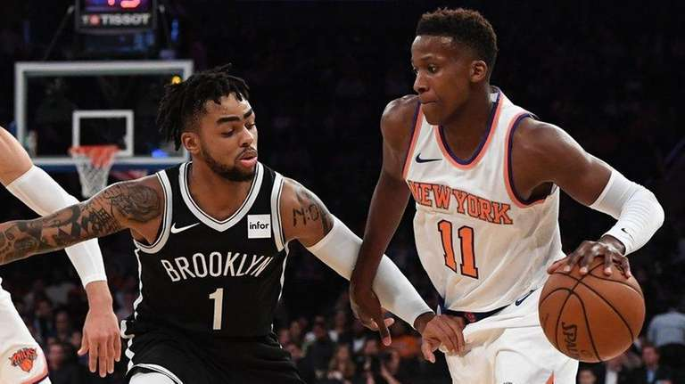 Knicks guard Frank Ntilikina is defended by Brooklyn