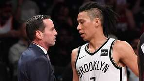 Brooklyn Nets head coach Kenny Atkinson talks with