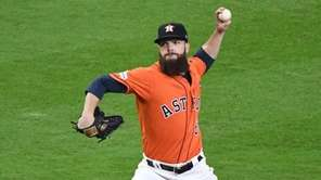 Astros pitcher Dallas Keuchel throws during ALCS Game