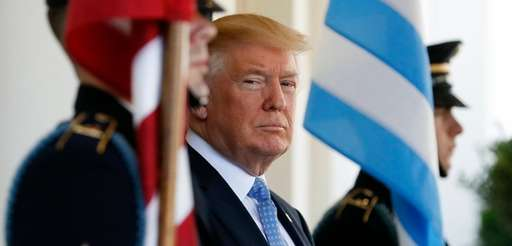 President Donald Trump waits to greet Greek Prime
