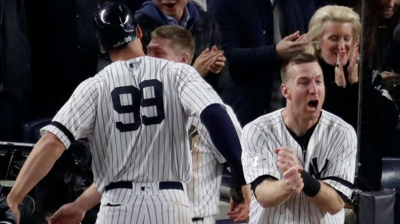Todd Frazier celebrates after Aaron Judge scored during