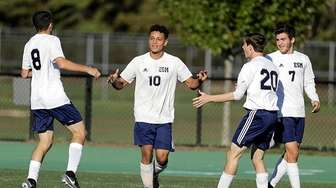Eastport-South Manor's David Velasquez (10) is congratulated by