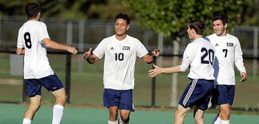 Eastport-South Manor's David Velasquez is congratulated by teammates after