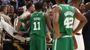 Celtics guard Kyrie Irving consoles Gordon Hayward after Hayward